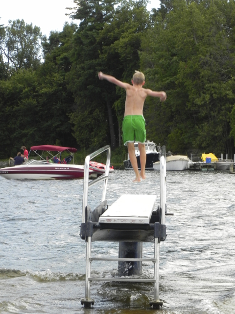 Jumping into Lake Champlain at the Basin Harbor Club