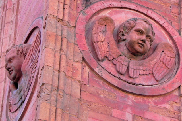 A pair of terracotta cherubs in Ferrara, Italy.